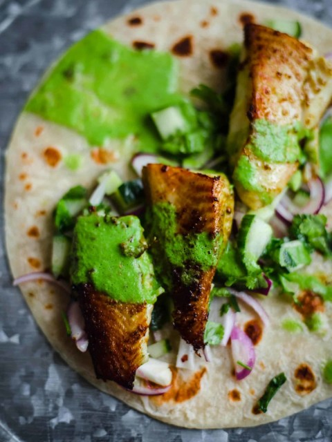 Fish Tikka on a roti with green chutney and salad