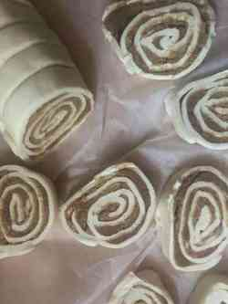 Puff pastry logs cut into rolls