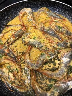 Tandoori Prawns cooking in a frying pan