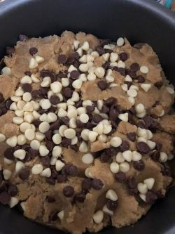 Another layer of cookie dough added on top od chocolate layer