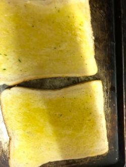 Buttered toast on tray