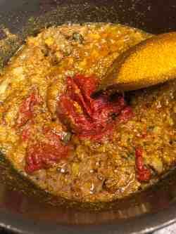 Tomato Puree added to pot