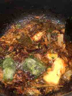 Garlic, Ginger and Green Chilli added to browned onions in pot