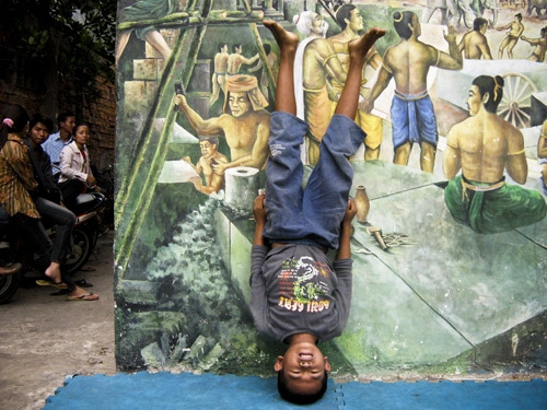 Cambodian Child Doing A Headstand