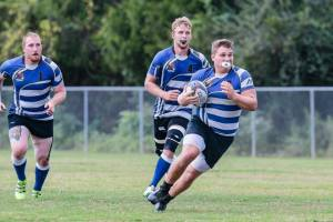 JT Henson leads his pod to the try line.