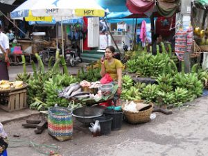 lady at local market on mobile phone Yangon