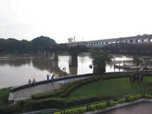 train crossing river kwai bridge kanchanaburi