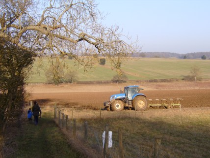 The child and I lagged behind while we watched the tractor plough