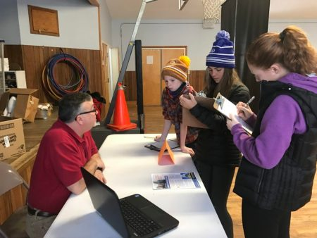 At their kickoff event, a trio of Burke Town School students quiz a community member on the needs of his organization.