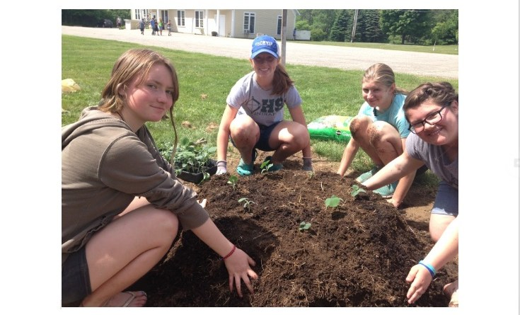 Burke Town School PBL: Students show off their first planting in the community garden, of seeds they started themselves in the greenhouse!