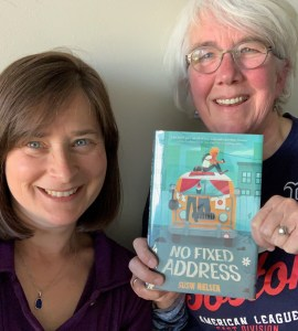 Host Jeanie Phillips, left, with guest Annie Brabazon, right and a copy of No Fixed Address.
