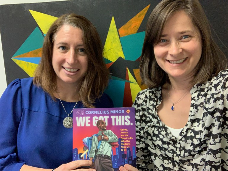 "Kathleen Brinegar (left) and Jeanie Phillips (right) with a copy of ""We Got This"", by Cornelius Minor"