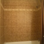 Kerdi porcelain shower with Travertine band