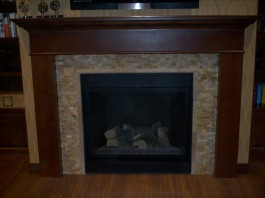 Split-faced stone fireplace installation in Fort Collins, CO