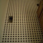 Octagonal mosaic tile floor installation with black dot in Erie, CO