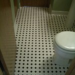 Octagonal mosaic tile floor installation with black dot in Northern Colorado