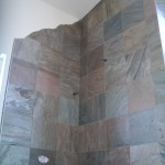 Slate master bathroom kerdi shower with relief silhouette