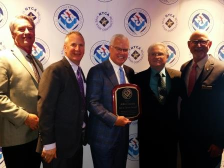 Jim Olson, NTCA's Assistant Executive Director, Bart Bettiga, NTCA's Executive Director, John Cousins, Joe Tarver Award Recipient, Joe Tarver, NTCA Executive Director Emeritus, and Martin Howard, NTCA's President