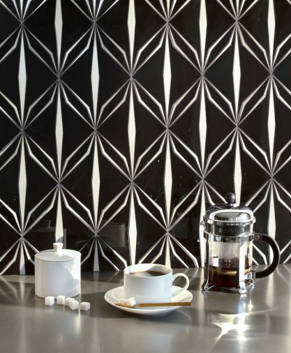 Èze, a waterjet mosaic shown in polished Nero Marquina and brushed Aluminum.