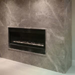 Bolder Panel Silver Shadow installed on a fireplace