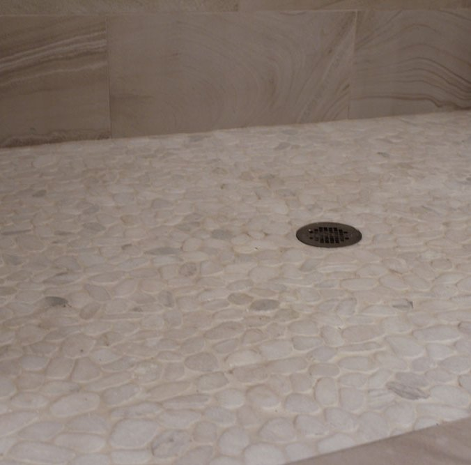 Snowflake Pebbles Mosaic installed in a shower base