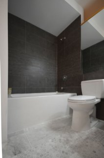 Modern Charcoal Porcelain Tile installed in a tub surround