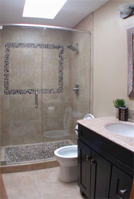 Beach pebbles stone mosaic installed in a shower