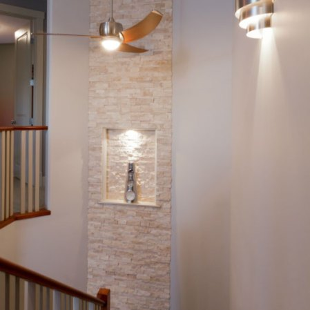 Ivory Splitface Random Strip Ledgestone installed as a feature wall. Install by Eiffel Tile