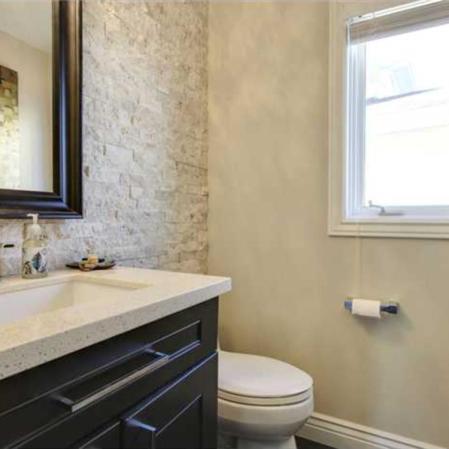 Ivory Splitface Ledgestone installed in a bathroom