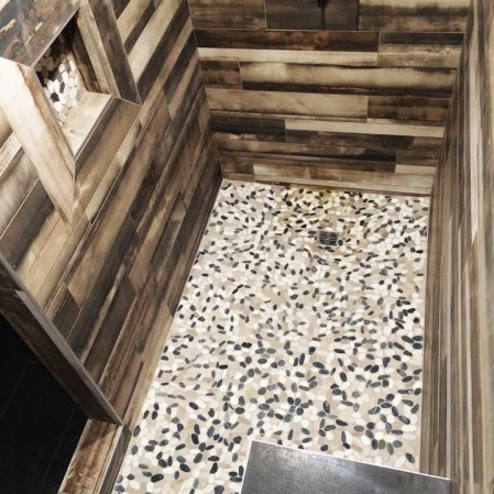 Bali Tranquil Cool Blend Flat Pebbles installed in a shower base