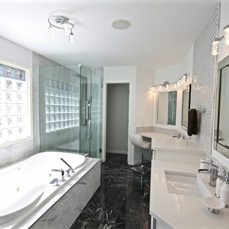 Bianco Cobalt Tile and Knot grey Mosaic installed in a classy bathroom