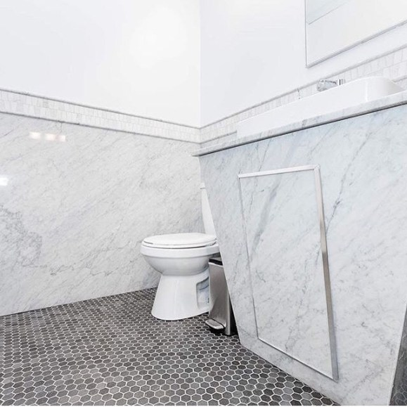Bianco Carrara Bolder Stone Panel installation in a bathroom