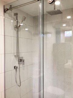 Prima True White Porcelain and Soho White Penny Rounds installed in a shower