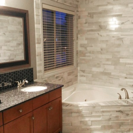 Bianco Cobalt Cubic Ledgestone, Equator Marble Tile and Stardust Hexagon Mosaic installed