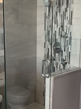 Essence Luz and Cathedral Alabastro installed in a shower stall