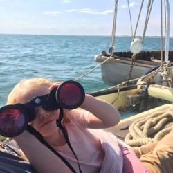 Young explorer with binoculars