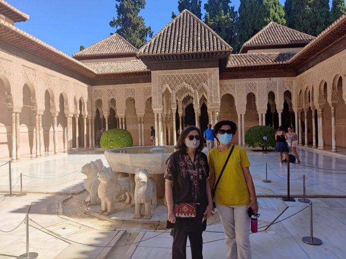 Anniqua and Selma Dos hermanas in the Patio of the Lions (Patio de los Leones) Outside  the Hall of Two Sisters