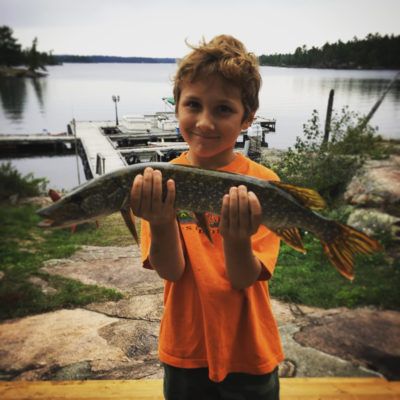 boy holding pike at the toque