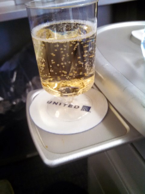 """Champagne"" in a plastic cup en route to Hong Kong."
