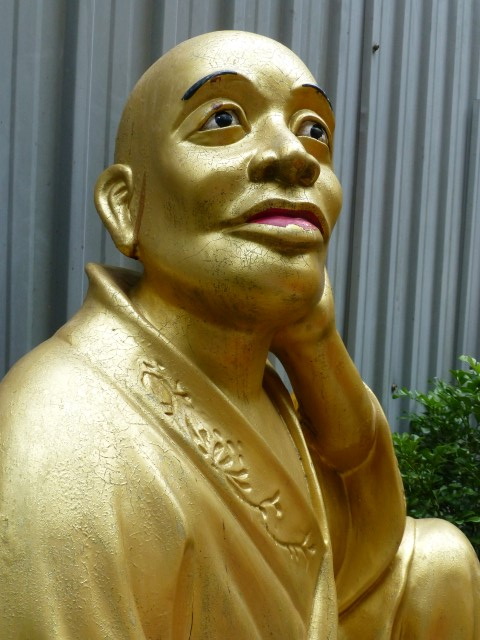 Wide-Eyed Buddha Dreaming of Better Times