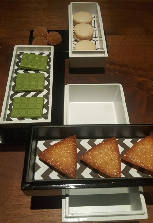 Mignardises - coconut macaroon, carrot-mandarin pâté de fruits, matcha white chocolate, yuzu financier.