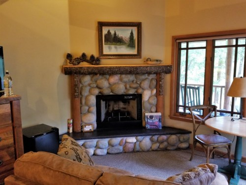 Our cabin's corner fireplace makes for a cozy retreat.