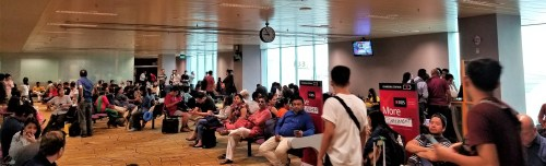 Very full boarding area at Changi International Airport