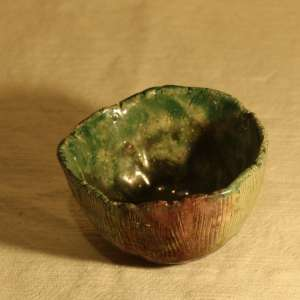 small raku bowl, green and copper, side vie
