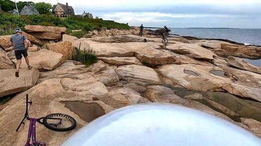 Trials bike riders on the rock ledge of the Narragansett, RI shoreline