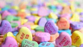 Close up of a pile of sweetheart candies