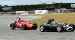 Graeme Hamilton (13) in a 1958 Ace III, heads off Russ Haines (56) in a 1965 Frangapelli Holden