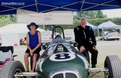 Judith and Phil Thomson, from Mosgiel, take a spell on the rear tires of their 1959 Daimler Special.