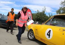 Pit coordinator, Wendy Sullivan, checks the cars in