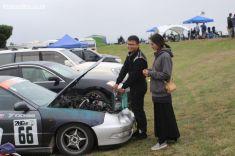 Wei Li, from Christchurch, adds oil to his Honda Integra